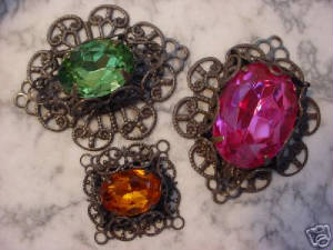 Examples Of Filigree Wrapped Rhinestones Glue On Top Of A Larger Hand Oxidized Filigree