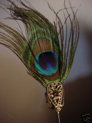 This Peacock Feather Hat Pin Was Made With Our Oxidized Brass Hat Pin Findings Topped With An Oxidized Brass Bow Shapped Filigree And A Bezel Set Vintage 6x4 Swarovski Crystal Amethyst Cabochon